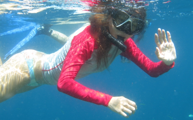 scuba-diving-girl-snorkeling-blue